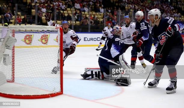 Rihards Bukarts of Latvia celebrates the equalizing goal during the 2018 IIHF Ice Hockey World Championship Group B game between United States and...