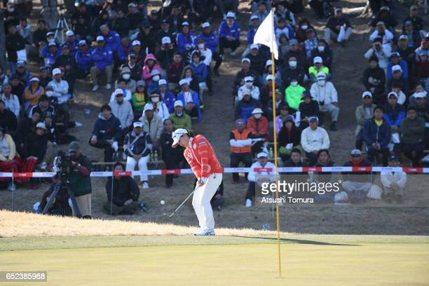 Riho Fujisaki of Japan chips onto the 18th green on the first playoff hole during the final round of the Yokohama Tire PRGR Ladies Cup at the Tosa...