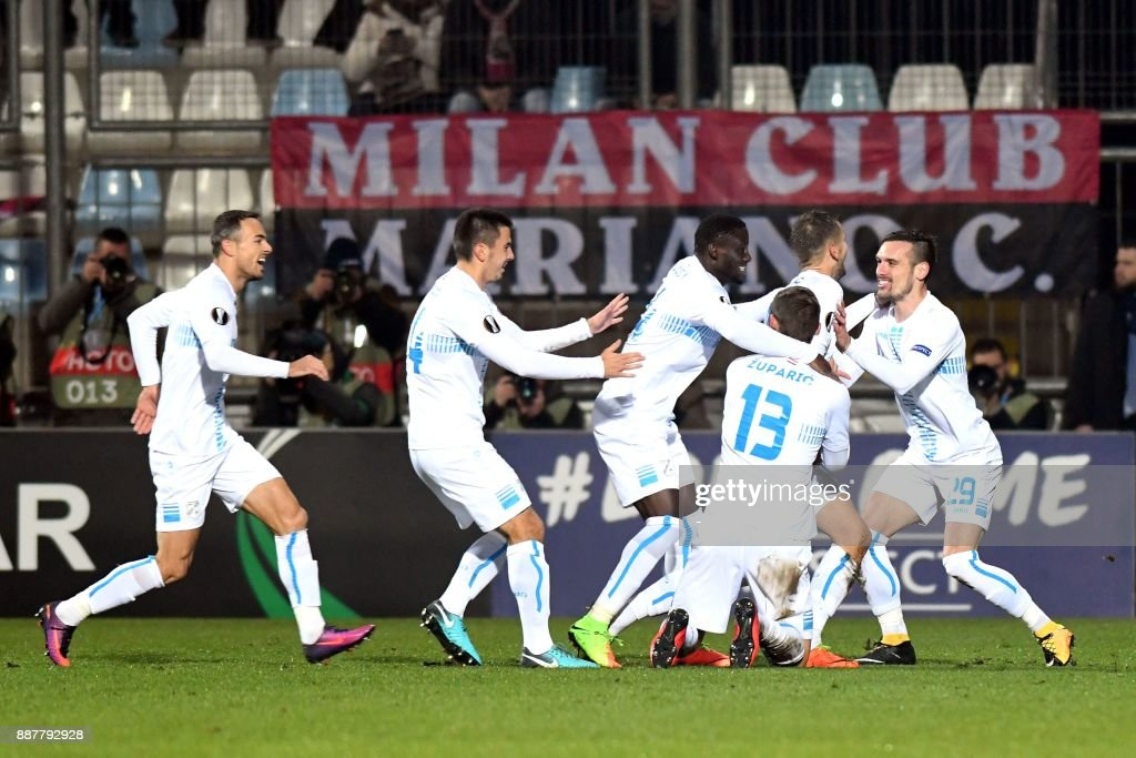 Rijeka's players celebrate after scoring a goal during the UEFA Europa League Group D football match between HNK Rijeka and AC Milan at the Rujevica Stadium in Rijeka on December 07, 2017. /