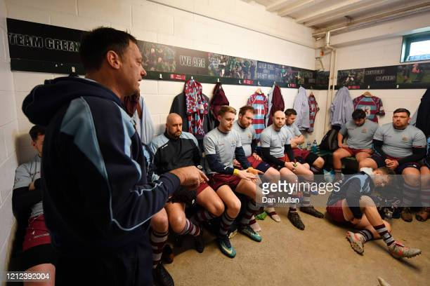 Rik Orkney Head Coach of OPMs speaks to his players in the changing room prior to the Lockie Cup Semi Final match between Old Plymouthian and...