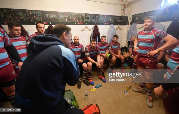 Rik Orkney Head Coach of OPMs talks to his players in the changing room at half time during the Lockie Cup Semi Final match between Old Plymouthian...