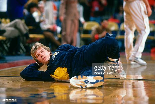 Rik Smits of the Indian Pacers in stretches prior to playing the Washington Bullets in an NBA basketball game circa 1995 at US Airways Arena in...