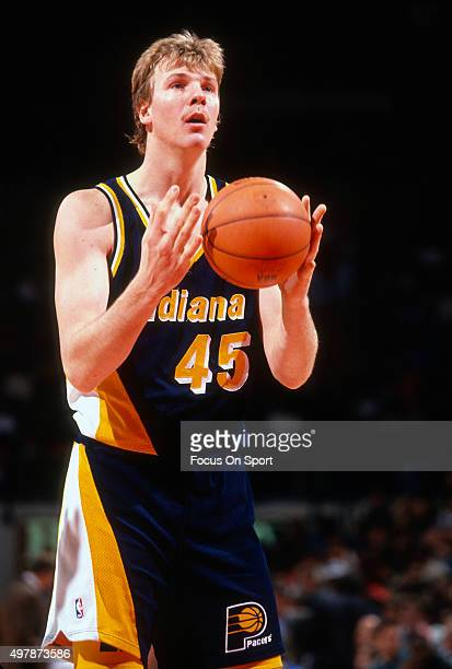 Rik Smits of the Indian Pacers looks to shoot a free throw against the Washington Bullets during an NBA basketball game circa 1995 at US Airways...