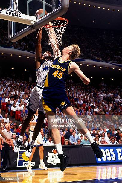 Rik Smits of the Indiana Pacers blocks the shot of Nick Anderson of the Orlando Magic during game 7 of the Eastern Conference Finals on June 4 1995...