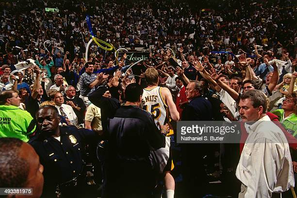 Rik Smits of the Indiana Pacers celebrates after hitting the game winning shot against the Orlando Magic during Game Four of the Eastern Conference...