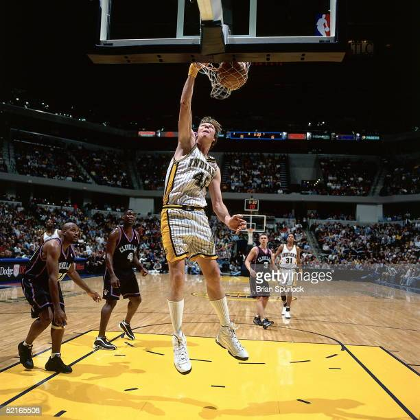 Rik Smits of the indiana Pacers goes up for a slam dunk against the Cleveland Cavaliers during an NBA game circa 2000 at Conseco Fieldhouse in...