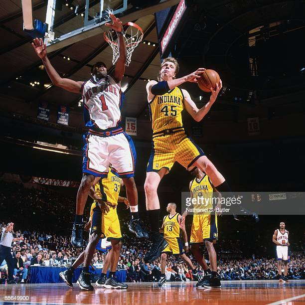 Rik Smits of the Indiana Pacers grabs a rebound against Chris Childs of the New York Knicks in Game Three of the Eastern Conference Finals during the...