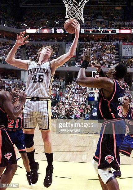 Rik Smits of the Indiana Pacers grabs a rebound from Patrick Ewing of the New York Knicks 31 May 2000 during the first half of their NBA Eastern...