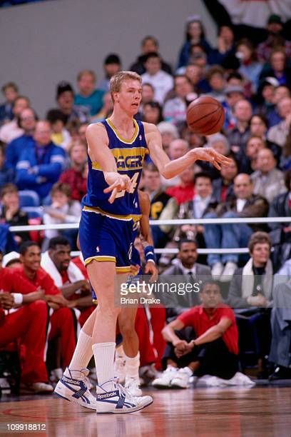 Rik Smits of the Indiana Pacers passes against the Portland Trailblazers circa 1990 at the Veterans Memorial Coliseum in Portland Oregon NOTE TO USER...