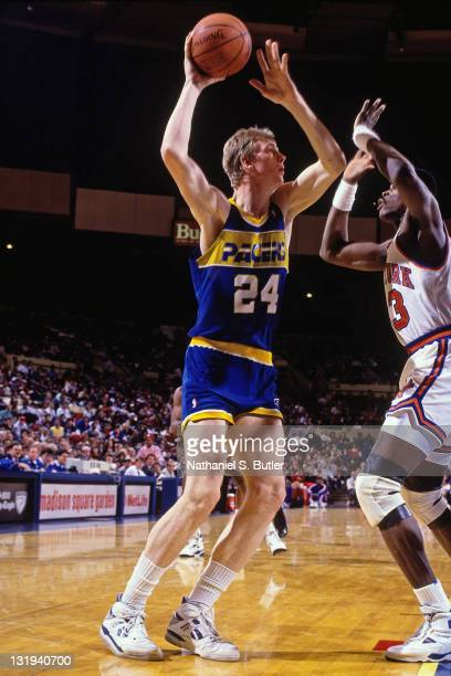 Rik Smits of the Indiana Pacers shoots against Patrick Ewing of the New York Knicks circa 1989 at Madison Square Garden in New York City NOTE TO USER...