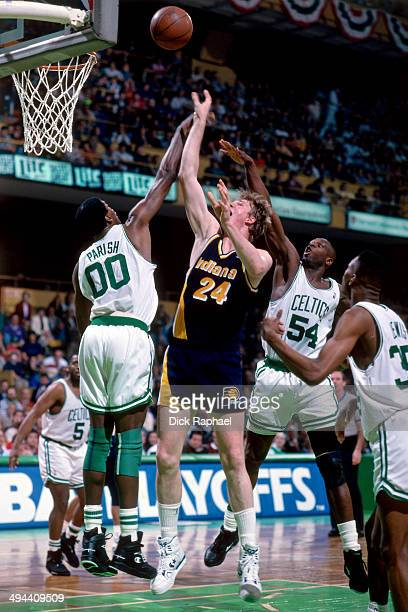 Rik Smits of the Indiana Pacers shoots against Robert Parish of the Boston Celtics during a game played in 1992 at the Boston Garden in Boston...