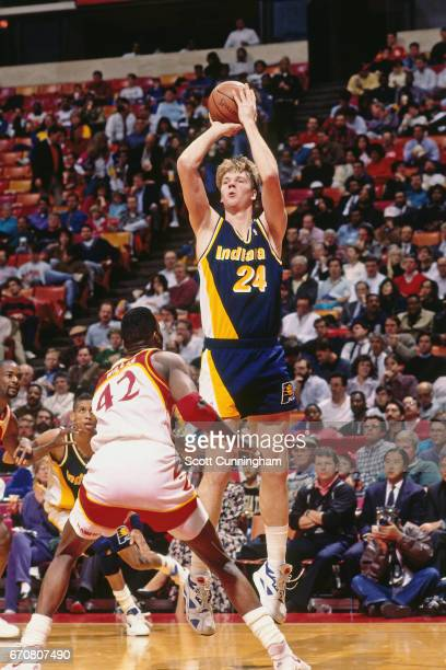 Rik Smits of the Indiana Pacers shoots against the Atlanta Hawks during a game played circa 1990 at the Omni in Atlanta Georgia NOTE TO USER User...
