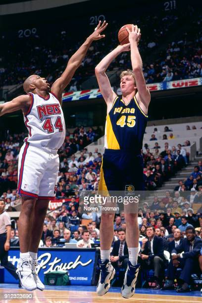 Rik Smits of the indiana Pacers shoots during a game played on January 3 1995 at Continetal Airlines Arena in East Rutherford New Jersey NOTE TO USER...