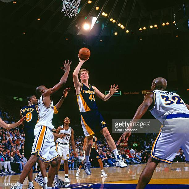 Rik Smits of the Indiana Pacers shoots the ball against the Golden State Warriors circa 1996 at the OaklandAlameda County Coliseum Arena in Oakland...