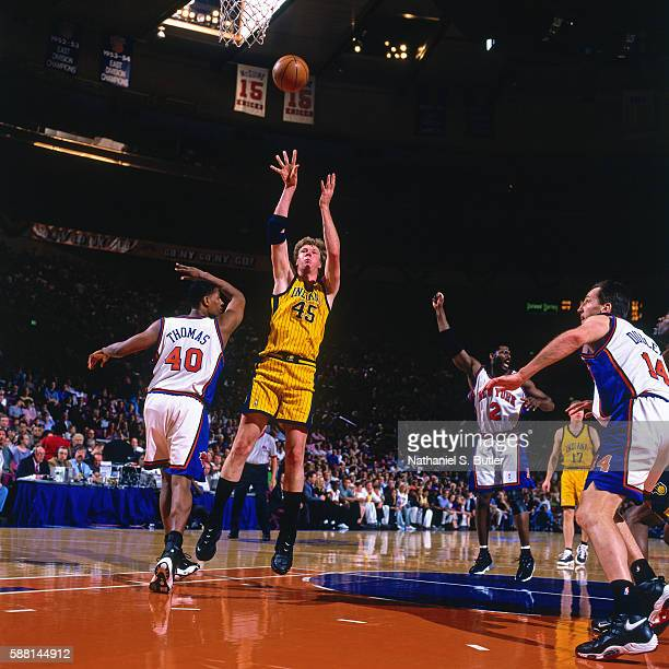 Rik Smits of the Indiana Pacers shoots the ball against the New York Knicks during the Eastern Conferece Finals on June 4 1999 at Madison Square...