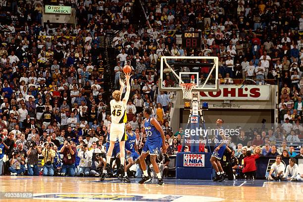 Rik Smits of the Indiana Pacers shoots the game winning shot against the Orlando Magic during Game Four of the Eastern Conference Finals on May 29...