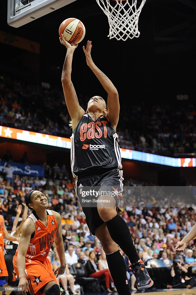 Érika de Souza #14 of the Eastern Conference All-Stars shoots against the Western Conference All-Stars during the 2013 Boost Mobile WNBA All-Star Game on July 27, 2013 at Mohegan Sun Arena in Uncasville, Connecticut.