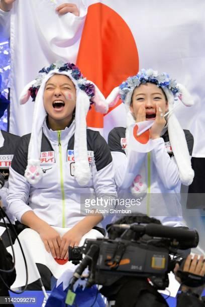 Rika Kihira and Kaori Sakamoto of Japan cheer for Keiji Tanaka competing in the Men's Single Short Program on day one of the ISU Team Trophy at...