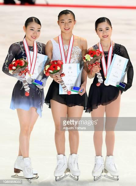 Rika Kihira Kaori Sakamoto and Satoko Miyahara pose with their medals after the ladies free skating during day three of the 87th Japan Figure Skating...