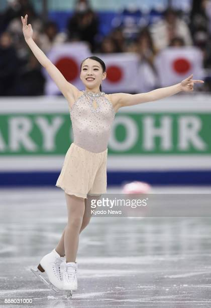 Rika Kihira of Japan acknowledges the crowd after performing in the women's short program at the Junior Grand Prix Final figure skating competition...