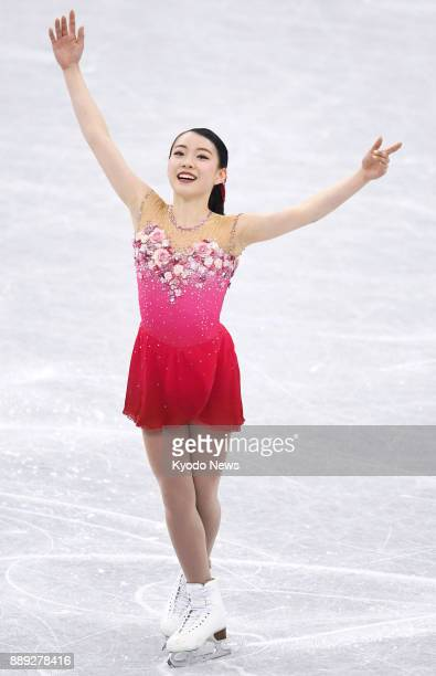 Rika Kihira of Japan acknowledges the crowd after performing in the women's free skate at the Junior Grand Prix Final competition in Nagoya on Dec 9...