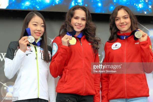 Rika Kihira of Japan Alina Zagitova of Russia and Evgenia Medvedeva of Russia pose for photographs at the small medal ceremony on day four of the...