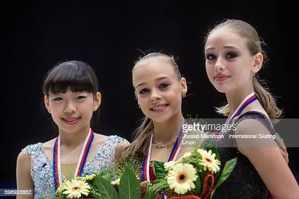Rika Kihira of Japan Anastasiia Gubanova and Alisa Lozko of Russia pose after the medal ceremony of the junior ladies free skating on day three of...