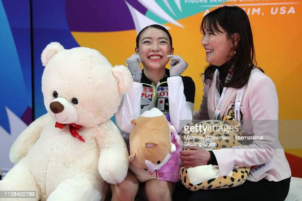 Rika Kihira of Japan celebrates in the Kiss Cry with her coach Mi Hamada after skating the Ladies Free Skate during the ISU Four Continents Figure...