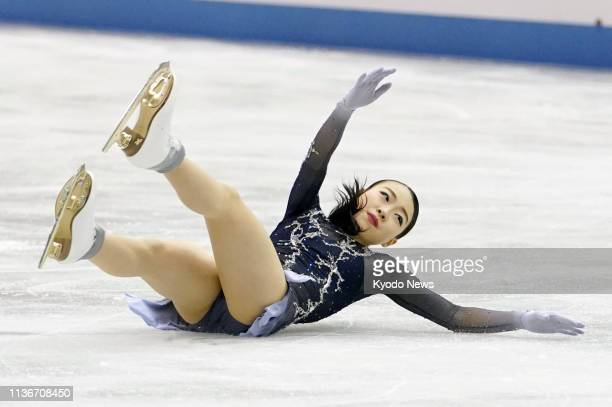 Rika Kihira of Japan falls on a triple axel attempt early in her free skate at the World Team Trophy figure skating competition in Fukuoka...