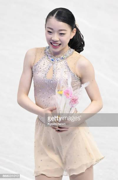 Rika Kihira of Japan holds flowers after performing in the women's short program at the Junior Grand Prix Final figure skating competition in Nagoya...