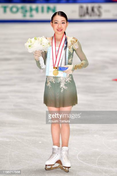 Rika Kihira of Japan poses with her gold medal during day three of the 88th All Japan Figure Skating Championships at the Yoyogi National Gymnasium...