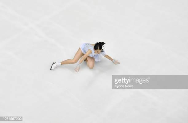 Rika Kihira, winner of the 2018 figure skating Grand Prix Final, falls during her short program at Japan's national championships in Kadoma, Osaka...