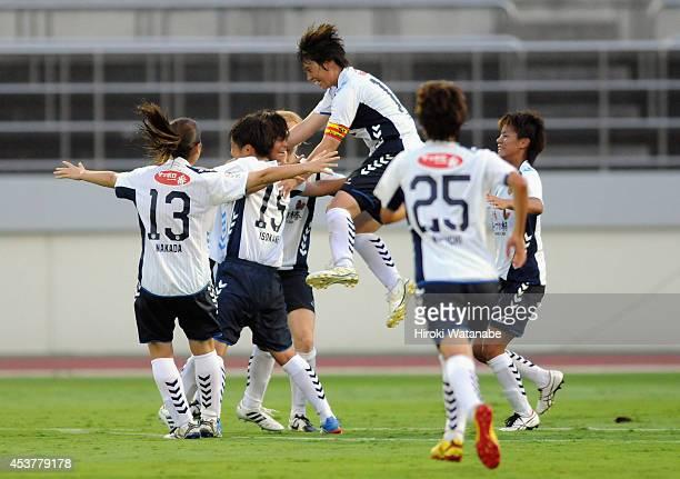 Rika Masuya of INAC celebrates scoring her team's first goal with her teammates during the Nadeshiko League match between Urawa Red Diamonds Ladies...
