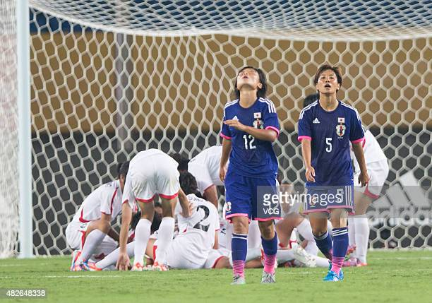 Rika Masuya of Japan and Ryoko Takara of Japan react during women's East Asian Cup football match between Japan and Korea at the Wuhan Sports Center...