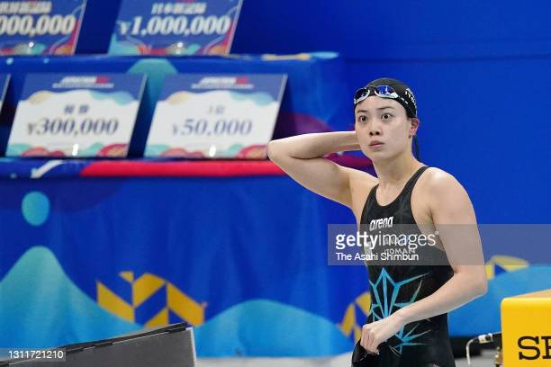 Rika Omoto reacts after competing in the Women's 50m Freestyle heat on day seven of the 97th Japan Swimming Championships at the Tokyo Aquatics...