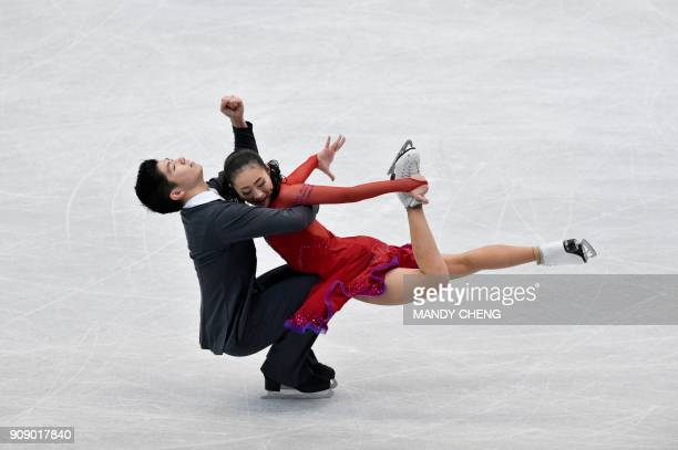 TOPSHOT Rikako Fukase and Aru Tateno of Japan perform at a practice session during the ice dance free dance at the ISU Four Continents Figure Skating...