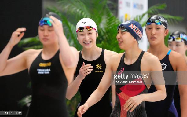 Rikako Ikee and Aya Sato are seen prior to competing in the Women's 50m Freestyle heat on day seven of the 97th Japan Swimming Championships at the...