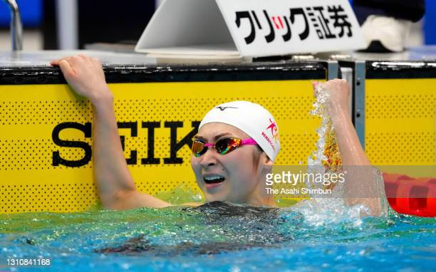 Rikako Ikee celebrates winning the Women's 100m Butterfly to qualify for the Tokyo Olympics on day two of the 97th Japan Swimming Championships at...