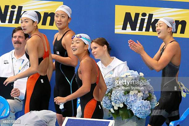 Rikako Ikee Chihiro Igarashi Sachi Mochida and Tomomi Aoki of Japan react after competing in the Women's 200x4 Freestyle Relay heat on day thirteen...