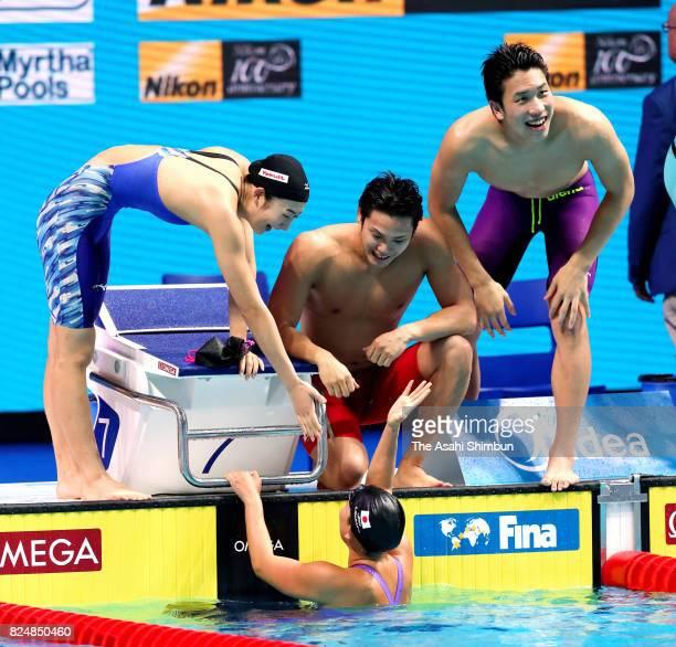 Rikako Ikee Katsumi Nakamura Katsuhiro Matsumoto and Chihiro Igarashi of Japan react after Mixed 4x100m Freestyle Relay final on day sixteen of the...