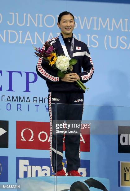 Rikako Ikee of Japan celebrates a gold medal on the podium after the Women's 100m Butterfly final during day 6 of the 6th FINA World Junior Swimming...