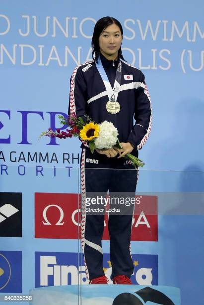 Rikako Ikee of Japan celebrates the gold medal on the podium after the Women's 50m Freestyle final during day 6 of the 6th FINA World Junior Swimming...