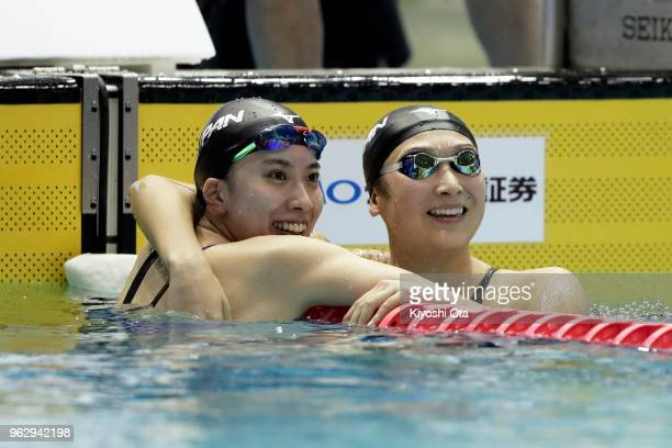 Rikako Ikee of Japan celebrates with Yui Ohashi of Japan after winning the Women's 100m Butterfly final on day four of the Swimming Japan Open at...