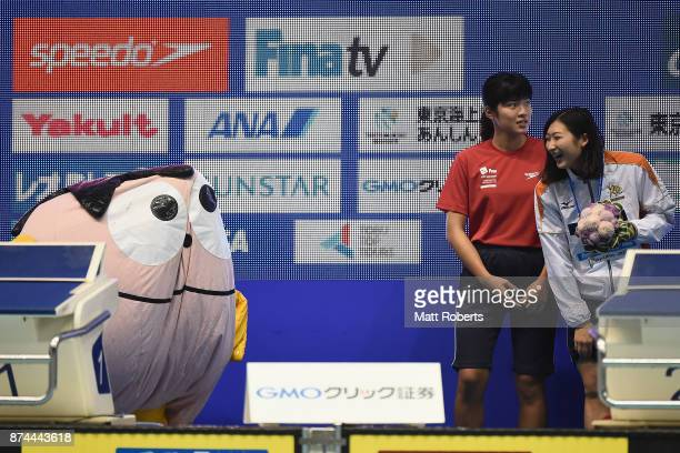 Rikako Ikee of Japan laughs as the mascot is seen deflating during the victory ceremony on day two of the FINA Swimming World Cup at Tokyo Tatsumi...
