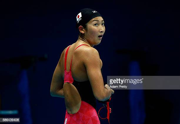 Rikako Ikee of Japan looks on following the Women's 100m Butterfly heat 6 on Day 1 of the Rio 2016 Olympic Games at the Olympic Aquatics Stadium on...
