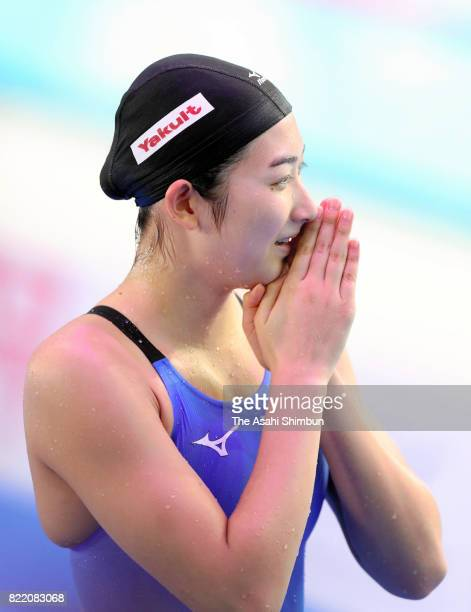 Rikako Ikee of Japan reacts after competing in the Women's 100m Butterfly final on day eleven of the Budapest 2017 FINA World Championships on July...