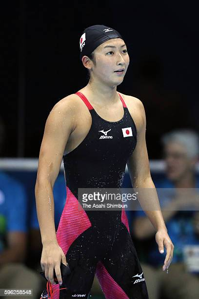 Rikako Ikee of Japan reacts after competing in the Women's 100m Butterfly heat on Day 1 of the Rio 2016 Olympic Games at the Olympic Aquatics Stadium...