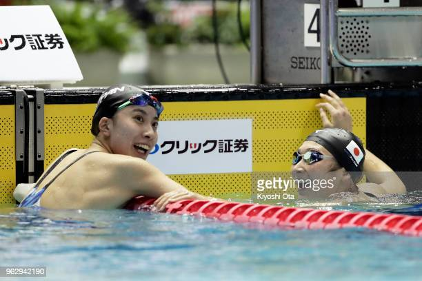 Rikako Ikee of Japan reacts with Yui Ohashi of Japan after winning the Women's 100m Butterfly final on day four of the Swimming Japan Open at Tokyo...