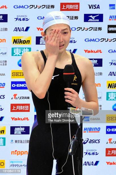 Rikako Ikee shows her emotion while interviewed after winning the Women's 100m Butterfly to qualify for the Tokyo Olympics on day two of the 97th...