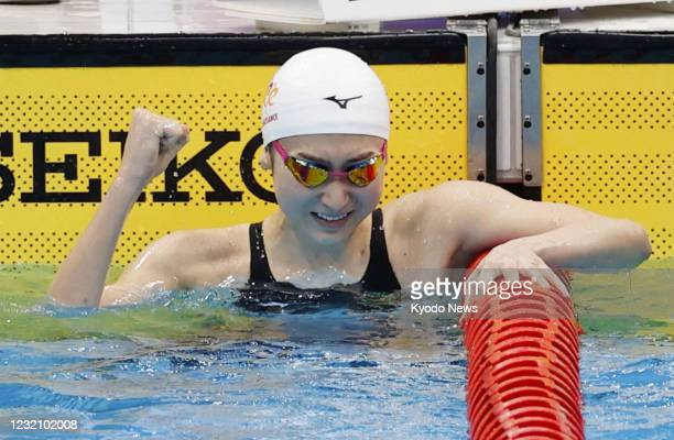 Rikako Ikee, who is recovering from leukemia, reacts after winning the women's 100-meter butterfly final at the national swimming championships at...